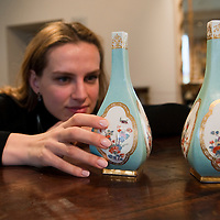 London November 24th Nette Megens a Bonhams Specialist poses with a  very rare pair of Meisen  vases from the Japanese Palce   dating circs 1732 that will be part of the Part 1  Hoffmeister Collection sale on Wednesday 25th November at Bonhams in London...***Agreed Fee's Apply To All Image Use***.Marco Secchi /Xianpix. tel +44 (0) 771 7298571. e-mail ms@msecchi.com .www.marcosecchi.com