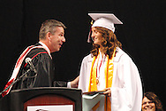 Principal Scott Butler (left) presents the salutatorian plaque to Hannah Turpin during the 142nd annual Lebanon High School commencement at the Nutter Center in Fairborn, Saturday, May 26, 2012.