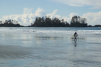 Chesterman Beach, near Tofino, BC Canada, approximately 3 kilometers of white sand and scattered rock outcroppings, is famous for West Coast surfing.