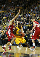 January 19 2013: Iowa Hawkeyes guard Anthony Clemmons (5) drives to the basket around Wisconsin Badgers guard Traevon Jackson (12) during the first half of the NCAA basketball game between the Wisconsin Badgers and the Iowa Hawkeyes at Carver-Hawkeye Arena in Iowa City, Iowa on Sautrday January 19 2013. Iowa defeated Wisconsin 70-66.