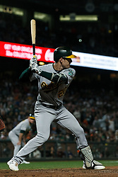 SAN FRANCISCO, CA - AUGUST 13: Mark Canha #20 of the Oakland Athletics at bat against the San Francisco Giants during the ninth inning at Oracle Park on August 13, 2019 in San Francisco, California. The San Francisco Giants defeated the Oakland Athletics 3-2. (Photo by Jason O. Watson/Getty Images) *** Local Caption *** Mark Canha