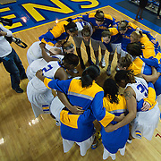 Photojournalist Suchat Pederson (Left) on assignment photographing The University of Delaware Women's Basketball team in the huddle on his day off prior to a NCAA college basketball game against Northeastern Sunday, Feb. 26, 2012 at the Bob Carpenter Center in Newark, Del.