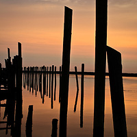Sunrise and pilings near the Dupont Nature Center in Mispillion Harbor, Milford, DE