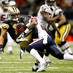 September 25, 2011; New Orleans, LA, USA; New Orleans Saints wide receiver Lance Moore (16) is hit by Houston Texans cornerback Kareem Jackson (25) after a catch during the fourth quarter at the Louisiana Superdome. The Saints defeated the Texans 40-33. Mandatory Credit: Derick E. Hingle
