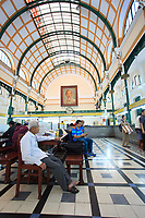 An elderly man who spends his days in his favourite seat at the Central Post Office in Ho Chi Minh City, Vietnam