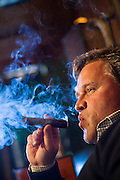 Jim Smith at his home in Fayetteville, Arkansas in his smoke room where he enjoys a cigar.<br /> <br /> <br /> <br /> <br /> <br /> <br /> <br /> FAYETTEVILLE, AR:  Jim Smith at his home in Fayetteville, Arkansas in his smoking den where he enjoys a cigar.  <br /> CREDIT: Wesley Hitt for The Wall Street Journal<br /> SMOKE-ARKANSAS<br /> <br /> <br /> <br /> <br /> <br /> <br /> FAYETTEVILLE, AR:  Views of the Jim Smith's smoking den in his house in Fayetteville, Arkansas on November 19, 2013. <br /> CREDIT: Wesley Hitt for The Wall Street Journal<br /> SMOKE-ARKANSAS