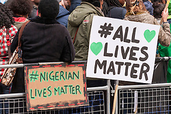 © Licensed to London News Pictures. 25/01/2015. Nigerian Embassy, London, UK. Demonstrators gather outside the Nigerian Embassy on Northumberland Avenue in London to protest against the militants of Boka Haram and the kidnapping of 200 schoolgirls.  The protestors demand answers, action and their freedom. Photo credit : Stephen Chung/LNP