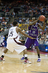 Holy Cross Crusaders guard Keith Simmons (10) is guarded by Southern Illinois Salukis guard Tony Young (15).  The #4 seed Southern Illinois Salukis defeated the #13 seed Holy Cross Crusaders 61-51  in the first round of the Men's NCAA Tournament in Columbus, OH on March 16, 2007.