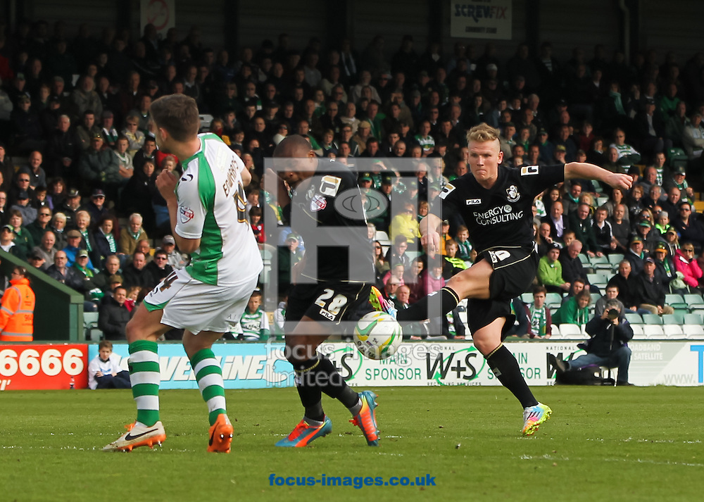 Matt Ritchie (right) of Bournemouth takes a shot at goal during the Sky Bet Championship match at Huish Park, Yeovil<br /> Picture by Tom Smith/Focus Images Ltd 07545141164<br /> 12/04/2014