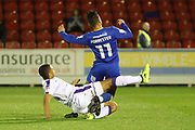 AFC Wimbledon attacker Harry Forrester (11) getting fouled during the EFL Trophy match between AFC Wimbledon and Luton Town at the Cherry Red Records Stadium, Kingston, England on 31 October 2017. Photo by Matthew Redman.