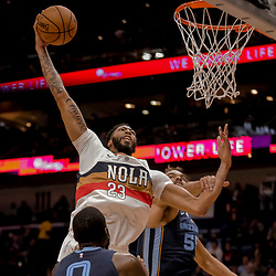 Jan 7, 2019; New Orleans, LA, USA; New Orleans Pelicans forward Anthony Davis (23) dunks over Memphis Grizzlies center Joakim Noah (55) and forward JaMychal Green (0) during the second half at the Smoothie King Center. Mandatory Credit: Derick E. Hingle-USA TODAY Sports