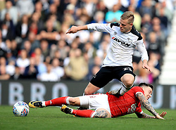 Nottingham Forest's Barrie McKay slides in on Derby County's Matej Vydra