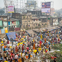 Jan 14, 2013 - Buyers and sellers crowd the streets the famed flower markets of Kolkata, India. <br /> <br /> Story Summary: It is said that the battle over global warming is to be won or lost in Asia. With growing populations and new economic boom in the global markets across Asia countries like India, Nepal and Cambodia have to grapple with the success and the environmental disaster that comes with ramped up production in unchecked or unregulated industries to compete in todays marketplace. The catastrophic air pollution makes for new problems to be dealt with such as a future health crisis, quality of life issues and the tarnished image of reduced visibility to world heritage sites for tourism.