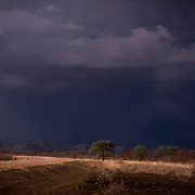 The first storms of the rainy season in South Kordofan. Due the last two years poor crops, the Nuba are longing for the rainy season to start. <br /> Again this year, it started very late, therefore putting them at risk of famine. <br /> Somewhere between Kauda and Buram