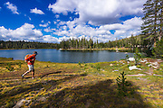 Hiker at Elizabeth Lake, Tuolumne Meadows, Yosemite National Park, California USA