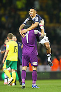 Picture by Paul Chesterton/Focus Images Ltd +44 7904 640267.26/01/2013.Mark Tyler (Luton Town) and Andre Gray (Luton Town) celebrate victory at the end of the The FA Cup 4th Round match at Carrow Road, Norwich.
