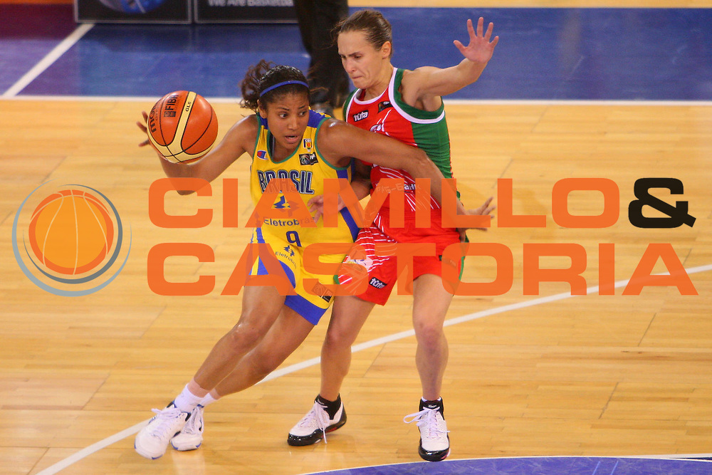 DESCRIZIONE : Madrid 2008 Fiba Olympic Qualifying Tournament For Women Quarter Finals Brazil Belarus <br /> GIOCATORE : Claudia Das Neves <br /> SQUADRA : Brazil Brasile <br /> EVENTO : 2008 Fiba Olympic Qualifying Tournament For Women <br /> GARA : Brazil Belarus Brasile Bielorussia <br /> DATA : 13/06/2008 <br /> CATEGORIA : Palleggio <br /> SPORT : Pallacanestro <br /> AUTORE : Agenzia Ciamillo-Castoria/S.Silvestri <br /> Galleria : 2008 Fiba Olympic Qualifying Tournament For Women<br /> Fotonotizia : Madrid 2008 Fiba Olympic Qualifying Tournament For Women Quater Finals Brazil Belarus <br /> Predefinita :