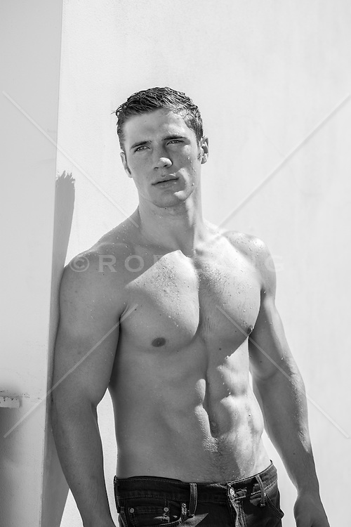 shirtless man with great abs outdoors