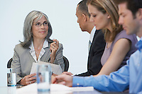 Business people sitting at conference table