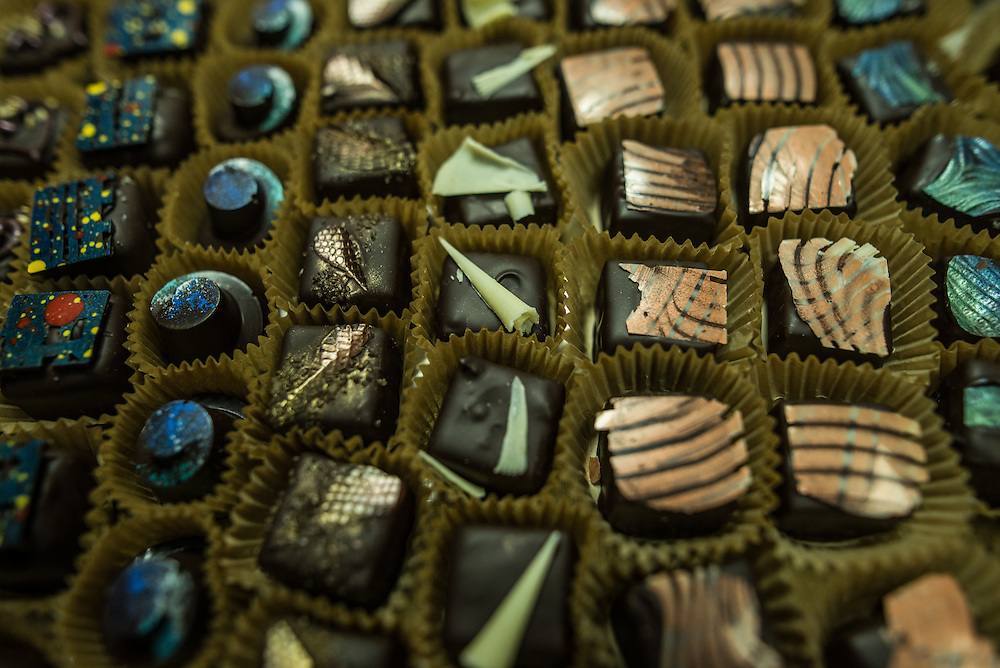 PORT OF SPAIN, TRINIDAD - FEBRUARY 13, 2017: Cocobel, exquisite chocolates made by chocolatier Isabel Brash, all produced with world-class cocoa beans from her family's estate in southern Trinidad and flavored with local ingredients like mango, scotch bonnet peppers, passion fruit and honey. Stock up on chocolate bars, barks and nibs in the foyer of the gorgeous wooden home that she also designed.  PHOTO: Meridith Kohut for The New York Times, 2016: