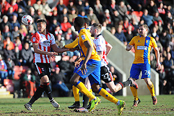 CJ Hamilton of Mansfield Town applies pressure on Kyle Wootton of Cheltenham Town- Mandatory by-line: Nizaam Jones/JMP- 04/03/2017 - FOOTBALL - LCI Rail Stadium - Cheltenham, England - Cheltenham Town v Mansfield Town -Sky Bet League Two