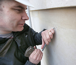 © Licensed to London News Pictures. 08/04/2013. National Memorial Arboretum, UK.  The painstaking process of engraving the names of UK Servicemen and women who were killed on duty or through terrorism in 2012 started today at the National Memorial Arboretum.  The engraver, Nick Hindle set to work with his hammer and chisel to make the first mark in the Portland Stone.  Photo credit: Alison Baskerville/LNP