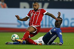 GELSENKIRCHEN, Sept. 20, 2017  Arturo Vidal (L) of Bayern Munich vies for the ball with Breel Embolo of Schalke 04 during their German Bundesliga match in Gelsenkirchen, Germany, on Sept. 19, 2017. Bayern Munich won 3-0. (Credit Image: © Joachim Bywaletz/Xinhua via ZUMA Wire)