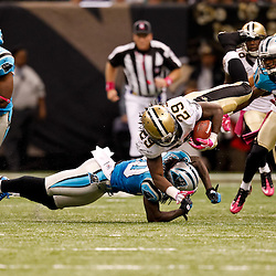 October 3, 2010; New Orleans, LA, USA; Carolina Panthers safety Charles Godfrey (30) upends New Orleans Saints running back Chris Ivory (29) during the second half at the Louisiana Superdome. The Saints defeated the Panthers 16-14. Mandatory Credit: Derick E. Hingle