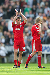 NEWCASTLE-UPON-TYNE, ENGLAND - Sunday, April 1, 2012: Liverpool's Jamie Carragher applauds the travelling supporters after his side's 2-0 defeat by Newcastle United during the Premiership match at St James' Park. (Pic by David Rawcliffe/Propaganda)