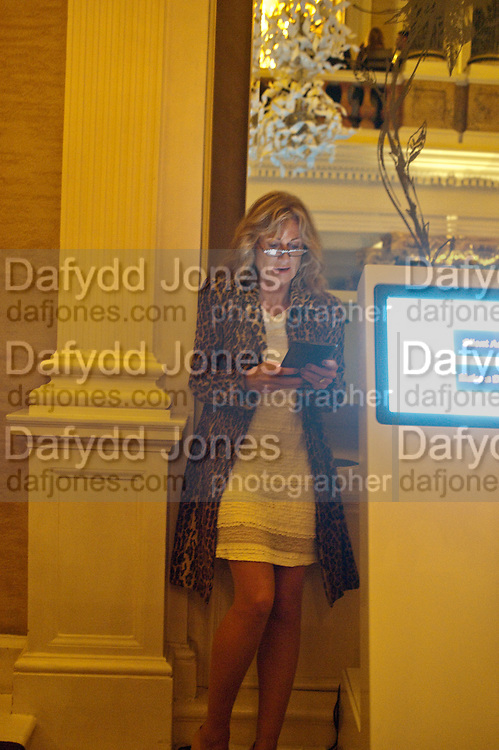 LADY ALISON MYNERS BIDDING ON PAD, Drinks soiree and silent auction of Ô100 ThingsÕ,  hosted by the Mayor of London Boris Johnson, in aid of the Legacy List. 50 St. James. London. 2 November 2011. <br /> <br />  , -DO NOT ARCHIVE-© Copyright Photograph by Dafydd Jones. 248 Clapham Rd. London SW9 0PZ. Tel 0207 820 0771. www.dafjones.com.<br /> LADY ALISON MYNERS BIDDING ON PAD, Drinks soiree and silent auction of '100 Things',  hosted by the Mayor of London Boris Johnson, in aid of the Legacy List. 50 St. James. London. 2 November 2011. <br /> <br />  , -DO NOT ARCHIVE-© Copyright Photograph by Dafydd Jones. 248 Clapham Rd. London SW9 0PZ. Tel 0207 820 0771. www.dafjones.com.