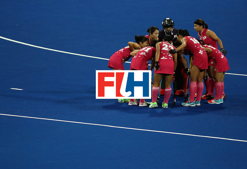 RIO DE JANEIRO, BRAZIL - AUGUST 08:  Japan huddles against Argentina during a Women's Pool B match on Day 3 of the Rio 2016 Olympic Games at the Olympic Hockey Centre on August 8, 2016 in Rio de Janeiro, Brazil.  (Photo by Sean M. Haffey/Getty Images)