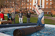 Bruce Belanger of the Great Lakes Timber Show demonstrates log rolling to students during the Extreme on the Green event at Ohio University on April 16, 2014.  Photo by Ohio University / Jonathan Adams
