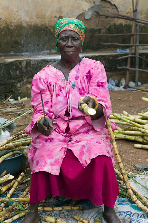 Portraits of people at a fish market on the Volta lake, Ghana 2011