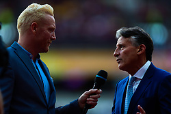 London, 2017-August-04. Lord Sebastian Coe speaks with Iwan Thomas MBE at the IAAF World Championships London 2017. Paul Davey.