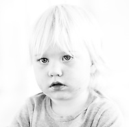 High Key image of a young boy. A studio photoshoot.  Images by Paul Gregg a Durban portrait and fashion / lifestyle photographer.