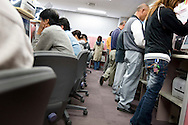 Sitting at desks and standing at computer work stations, people fill in job applications and seek work, at the 'Hello Work' employment office, in Toyota city, Japan, on Tuesday 21st April 2009.  In the first 3 months of 2009 the numbers of people seeking work at the 'hello Work' employment office rose 133% compared to the first quarter of 2008. This increase is due to the jobs lost in the industries and companies which serve and supply the Toyota car company and automobile industry, for which Toyota city is famous.