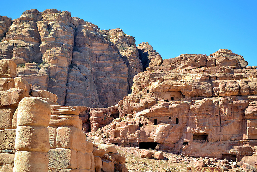 Jebal Habis Unfinished Tomb and Crusaders Castle in Petra, Jordan<br /> Dwarfed by the much larger Umm al-Beyyara mountain on the left, the Jebal Habis mount on the right is far more fascinating.  The face of the cliff shows evidence of an enormous and elaborate unfinished tomb. Had it been completed, it would have been one of the largest burial monuments in Petra.  Less visible in this photo are the ruins of a Crusaders castle at the peak. The al-Habis fortress was built in 1115 AD but is now mostly in ruins.