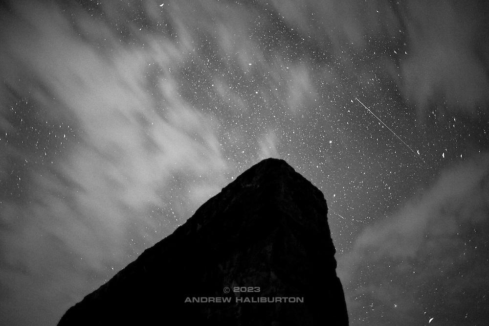 Shooting star passes over Stonehenge at Maryhill, Washington. Nikon D700, 28/2 Ai.