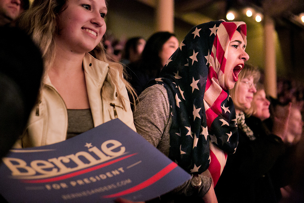"""CHICAGO, IL - MARCH 15, 2015: Muryem Quadri, an 18-year-old Muslim from Chicago waits to hear Democratic presidential candidate Bernie Sanders speak at a campaign rally in Chicago, Illinois. """"I have this strapped on my head because Trump wants to take it away from me,"""" she said of her American flag hijab. CREDIT: Sam Hodgson for The New York Times."""