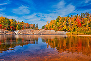 Reflection on the Aux Sables River in autumn<br />