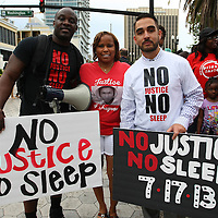 "Event organizers Olumide Ajile (L) and Shayan Modarres (r) pose with a supporter prior to the No Justice No Peace- ""March Against Gun Violence""  walk from Lake Eola in downtown Orlando, to the Orange County Courthouse on Wednesday, July 17, 2013. The march was organized by the Modarres Law Firm and Orlando attorney Natalie Jackson, one of the attorneys for Trayvon Martins parents. (AP Photo/Alex Menendez)"