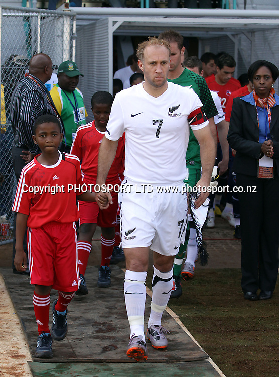 Captain Simon Elliott leads the All Whites onto the field.<br />