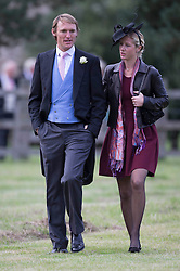 Mark Tomlinson and his wife  Laura Bechtolsheimer attend the wedding of James Meade and Lady Marsham the daughter of Earl of Romney in Gayton, Norfolk, United Kingdom. Saturday, 14th September 2013. Picture by i-Images