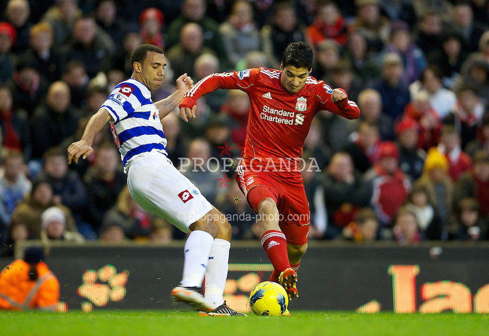 LIVERPOOL, ENGLAND - Saturday, December 10, 2011: Liverpool's Luis Alberto Suarez Diaz in action against Queens Park Rangers' Anton Ferdinand during the Premiership match at Anfield. (Pic by David Rawcliffe/Propaganda)