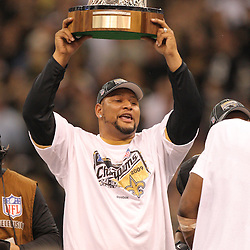 Jan 24, 2010; New Orleans, LA, USA; Former New Orleans Saints running back Deuce McAllister holds up NFC Championship trophy following an overtime victory over the Minnesota Vikings in the 2010 NFC Championship game at the Louisiana Superdome. Mandatory Credit: Derick E. Hingle-US PRESSWIRE