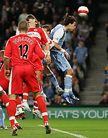 Photo: Paul Thomas.<br /> Manchester City v Middlesbrough. The Barclays Premiership. 30/10/2006.<br /> <br /> Richard Dunne (Out of picture behind number red 12) of Man City scores with a header.
