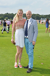 MATT DAWSON and CAROLIN HAUSKELLER at the Audi International Polo at Guards Polo Club, Windsor Great Park, Egham, Surrey on 26th July 2014.