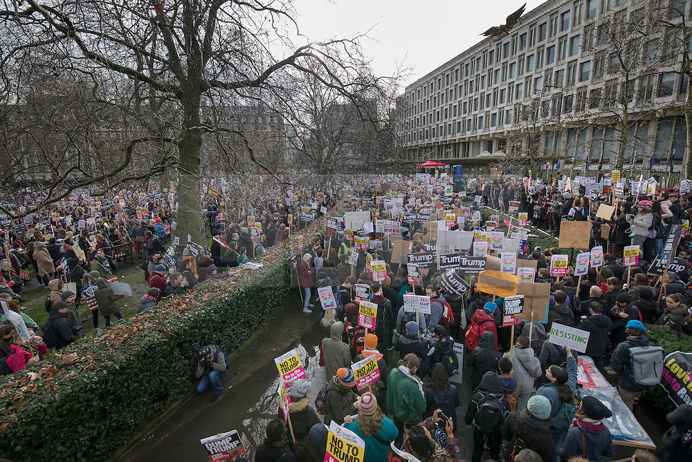 © Licensed to London News Pictures. 04/02/2017. London, UK. Protestors gather outside the US Embassy in a demonstration against U.S President Donald Trump's Executive Order banning refugees and immigrants from a number of Muslim-majority countries. Protestors join campaign groups including Stop the War, Stand up to Racism, Muslim Association of Britain, in a march from the U.S Embassy in London to Downing Street. Photo credit: Peter Macdiarmid/LNP