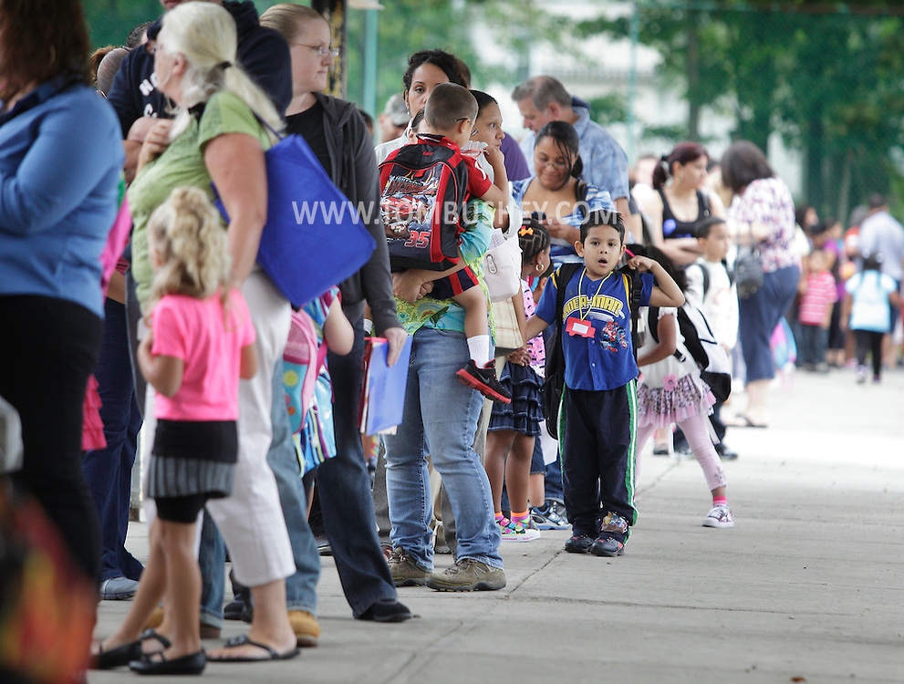 "New kindergarten students and their parents or guardians line up outside Chorley Elementary School in Middletown during ""Bring Your Kids to Kindergarten Day"" on Thursday, Sept. 6, 2012."