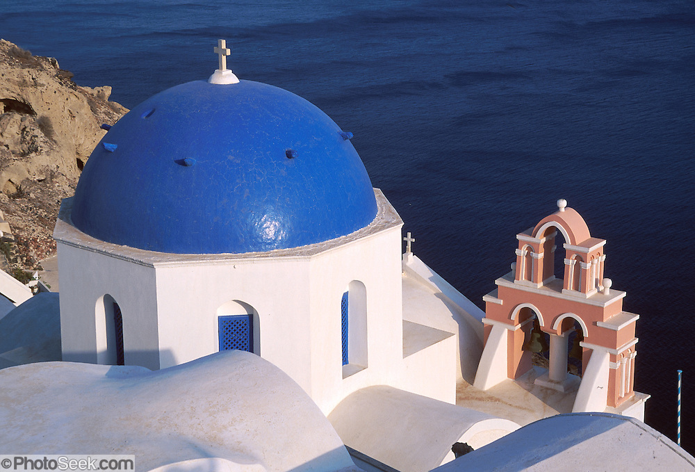 Blue-domed Greek Orthodox Church in Oia village, Santorini Island, Greece, Europe.